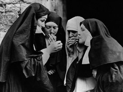 Nuns Lighting Cigarettes